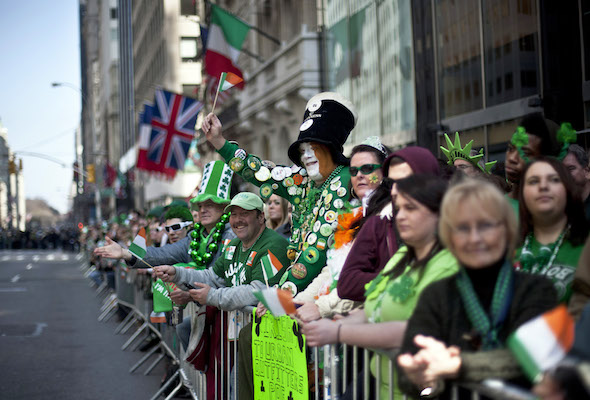 NEW YORK, NY - MARCH 17:  Revelers cheer on the marchers during the 251st annual St. Patrick's Day Parade March 17, 2012 in New York City. The parade honors the patron saint of Ireland and was held for the first time in New York on March 17, 1762, 14 years before the signing of the Declaration of Independence. (Photo by Allison Joyce/Getty Images)