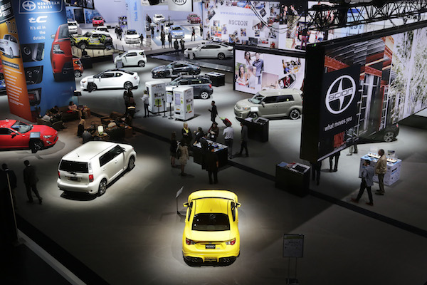 Cars from Toyota's Scion brand, foreground, are part the New York International Auto Show, Thursday, April 17, 2014 in New York. (AP Photo/Mark Lennihan)